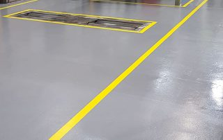 workshop bay for cars with grey resin flooring