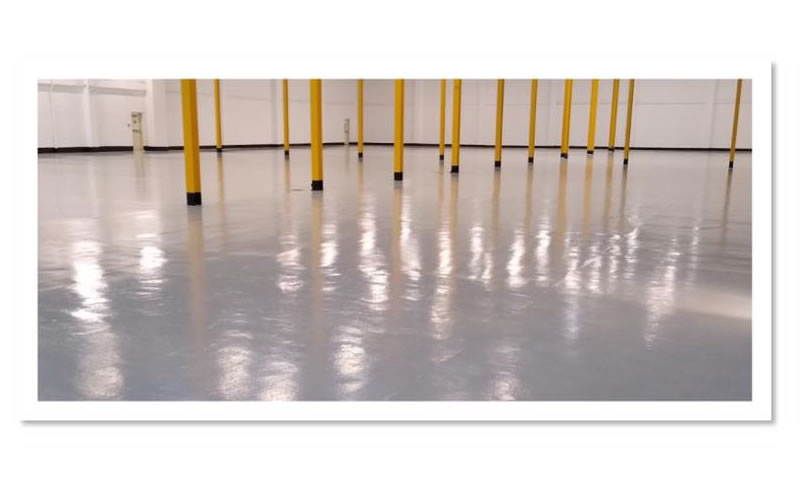 grey epoxy flooring with yellow posts