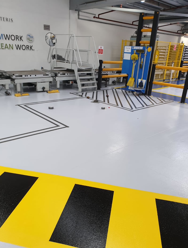 completed epoxy coating with yellow and black demarcation