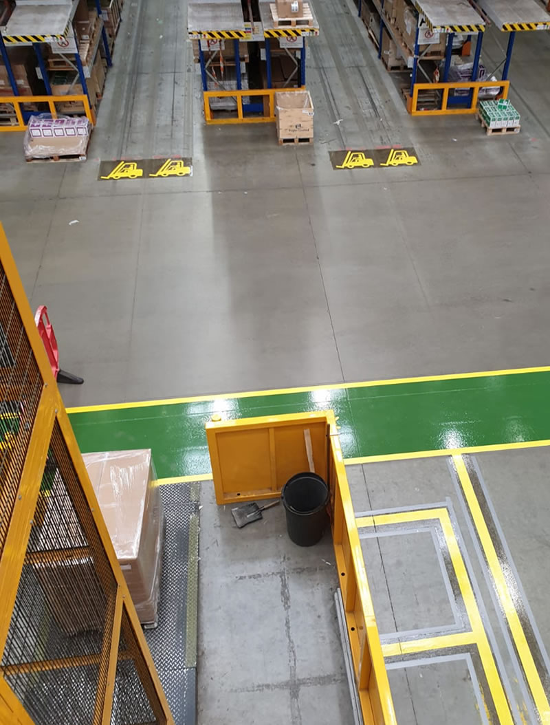 green walkway and yellow fork lift route