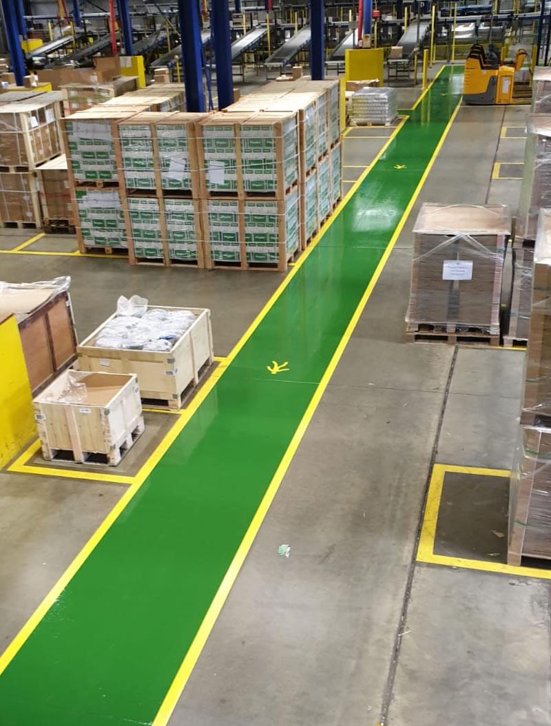 long pedestrian walkway in a warehouse