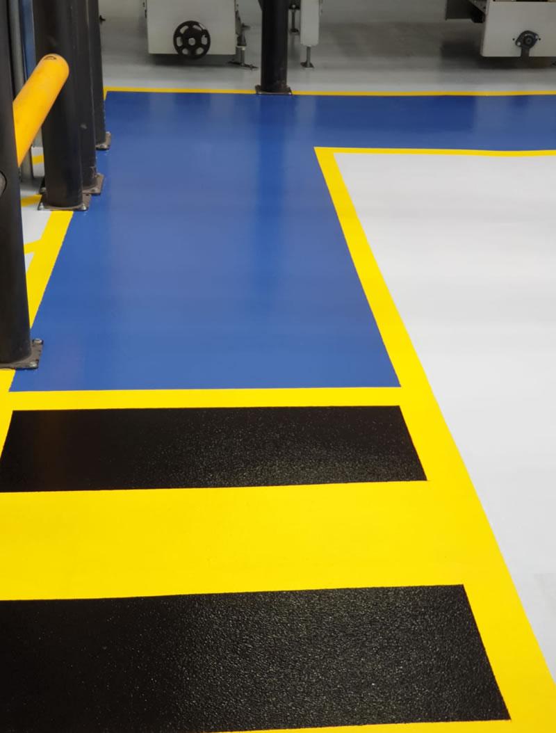 pedestrain walkway in blue yellow and black