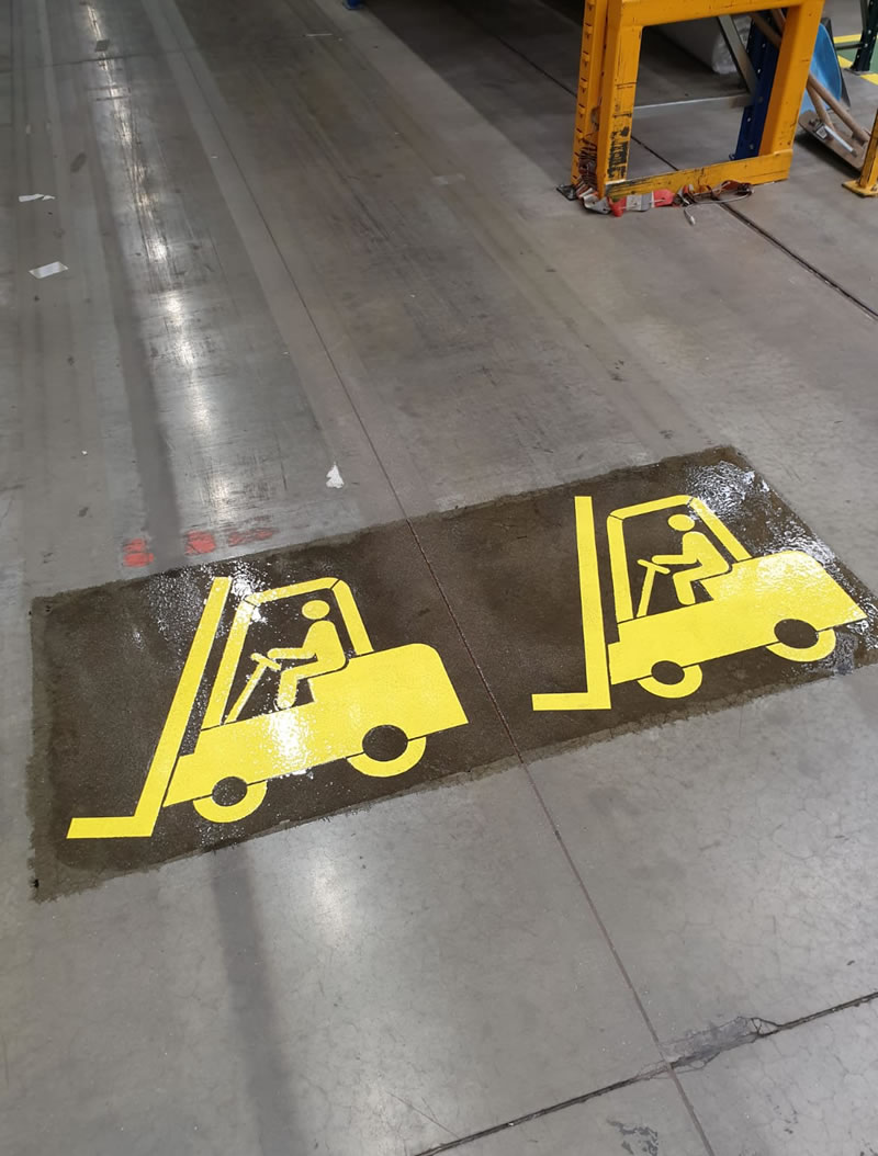 yellow fork lift route on the floor