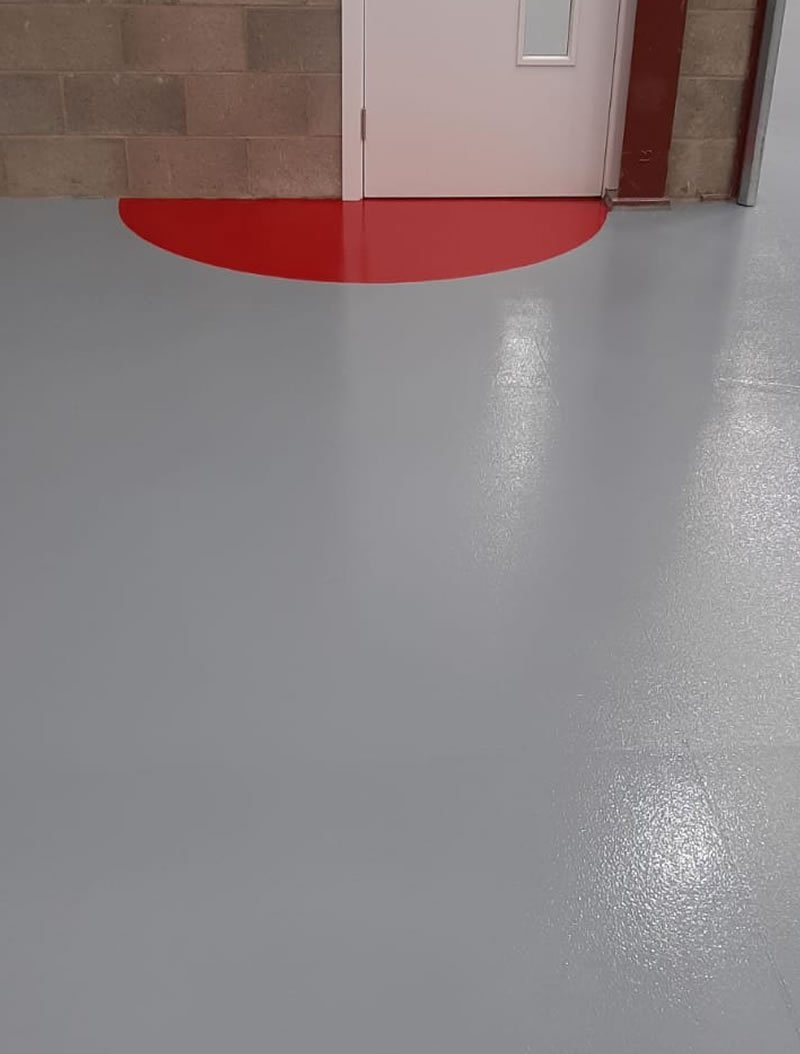 grey and red resin flooring