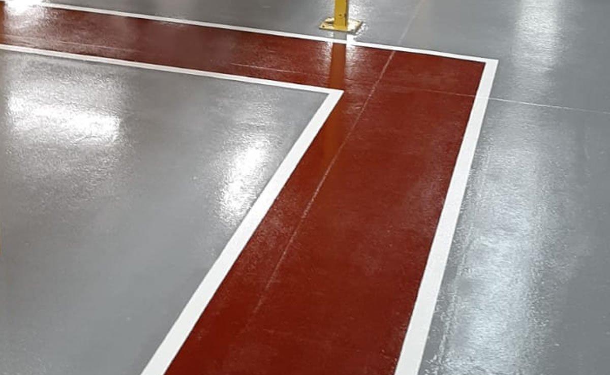 grey resin coating and red pedestrian walkway