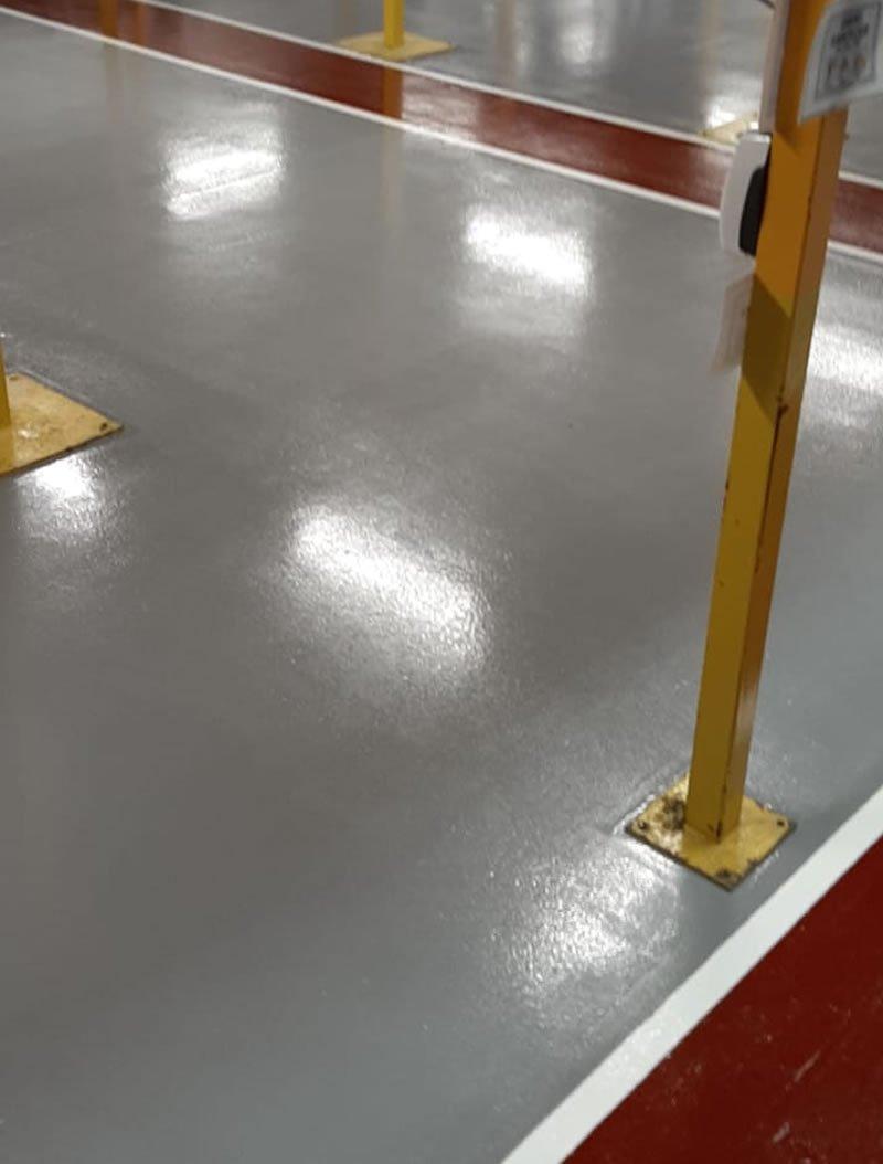 grey resin floor with red floor markings