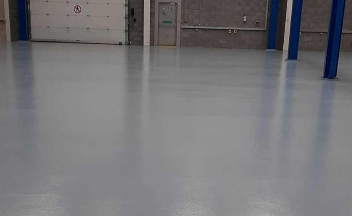 grey resin flooring in a warehouse