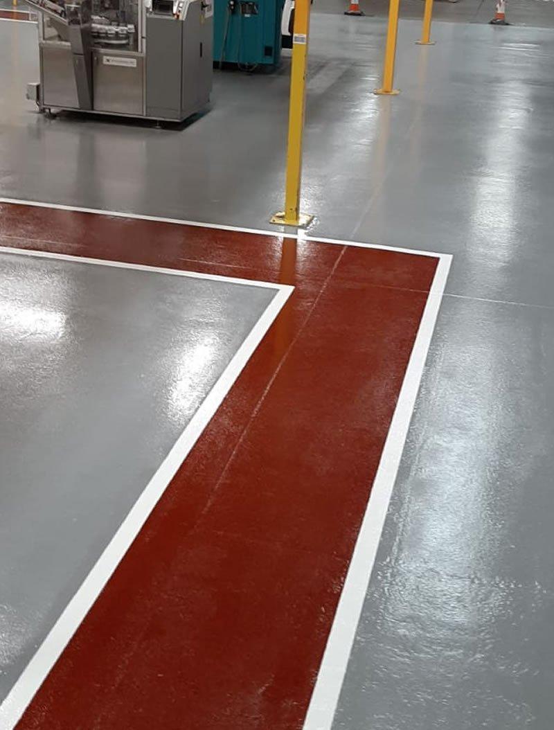 pedestrian walkway marked on grey resin floor