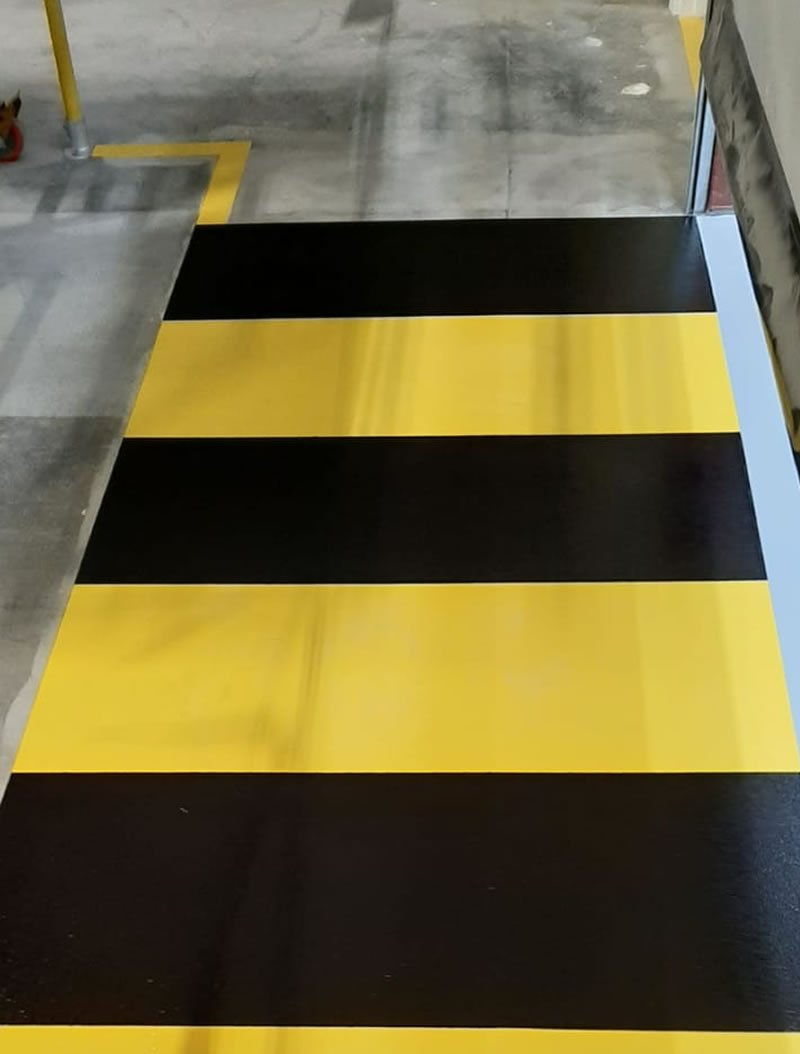 yellow and black zebra demarcation for pedestrians