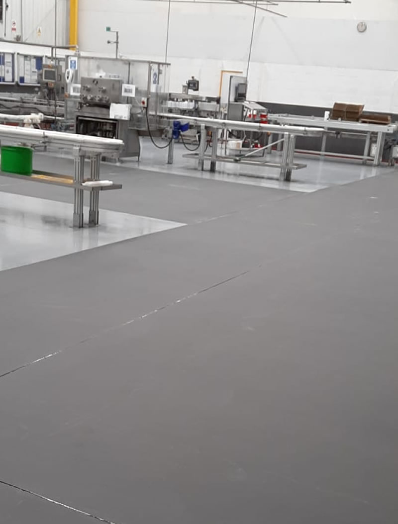 completed resin floor in grey for a manufacturer