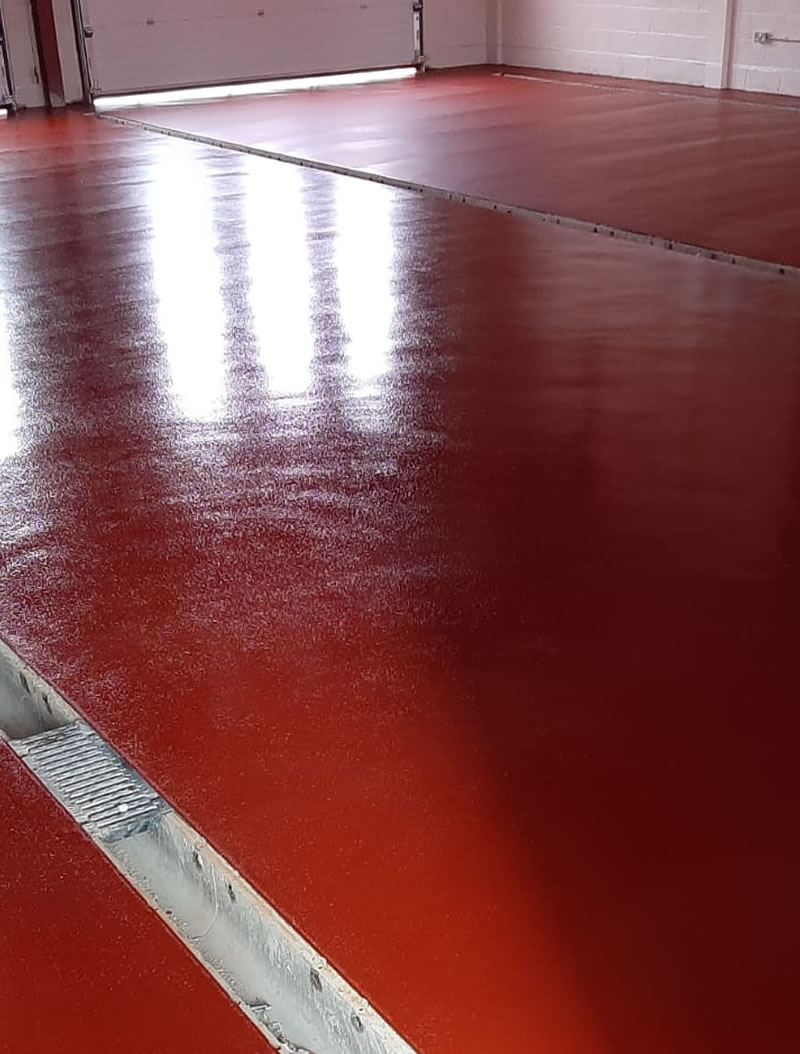 resin flooring being installed in a fire station
