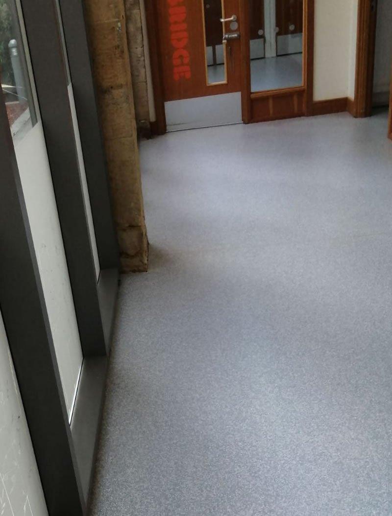 new grey decorative floor in a corridor