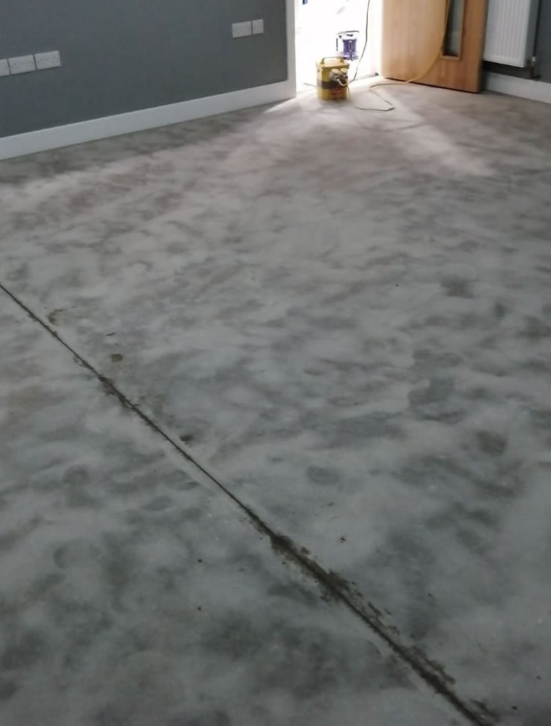 preparing a concrete floor for a resin coating