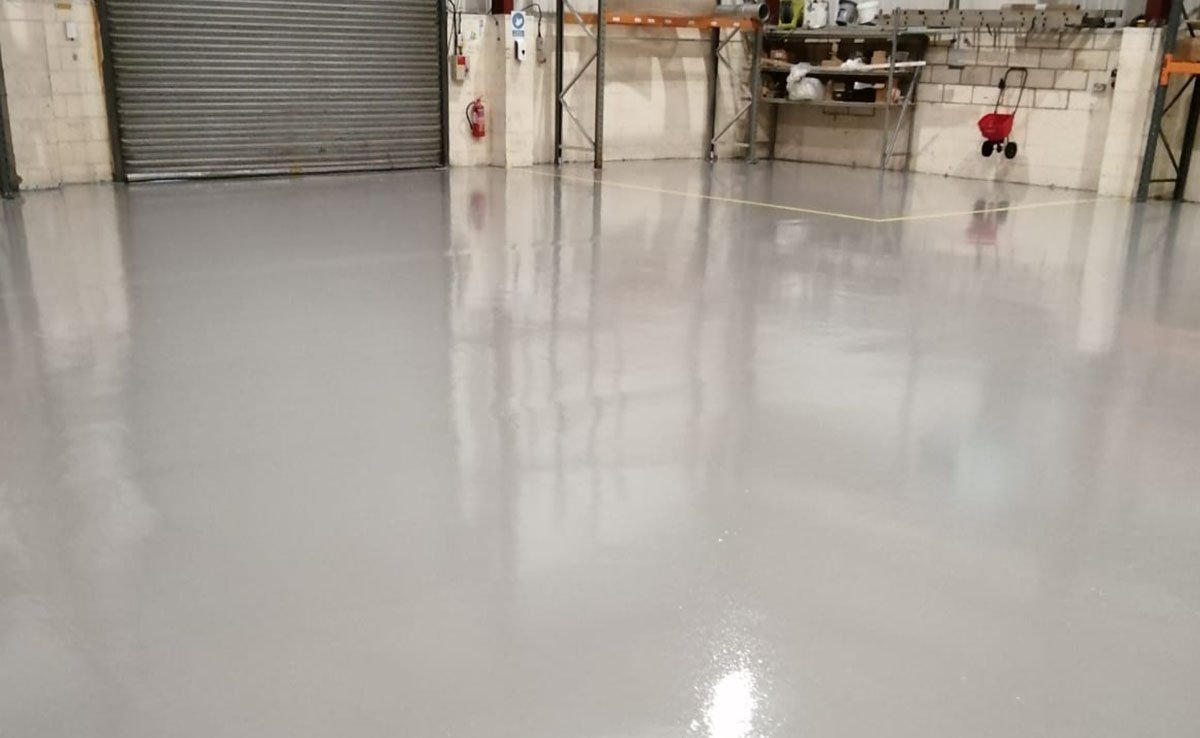 completed grey resin flooring in a warehouse