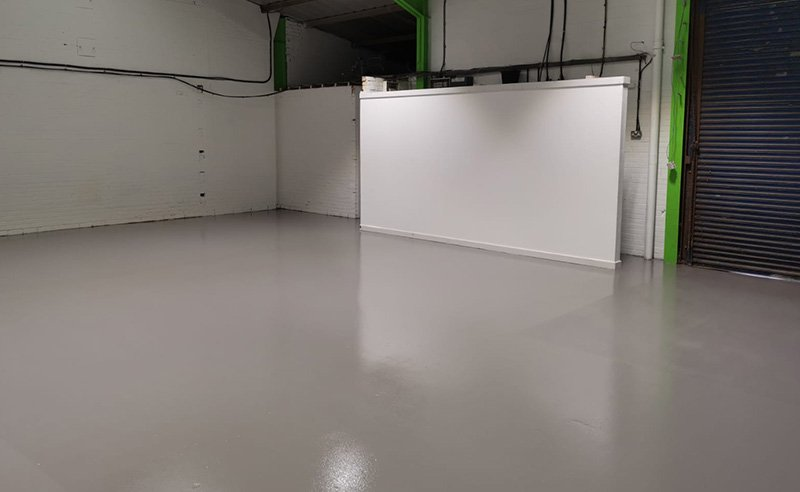 completed resin floor installation for a vehicle workshop