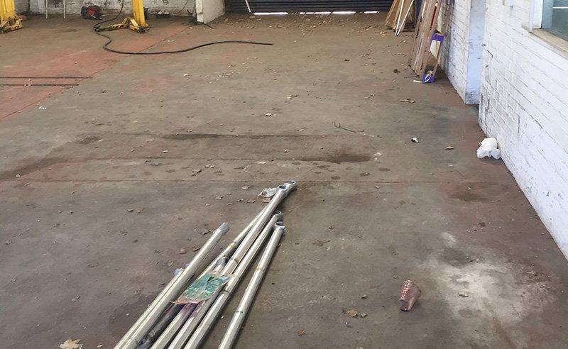 concrete workshop floor before work started