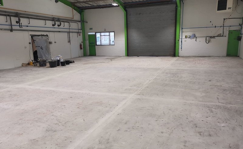workshop floor after the concrete substrate was repaired and ready for the resin