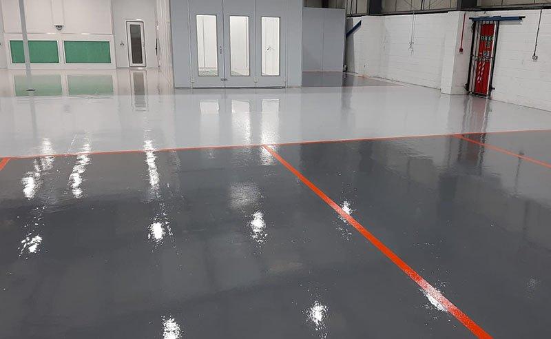 grey resin flooring with orange demarcation