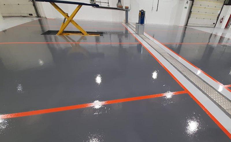 orange demarcation on a grey resin floor