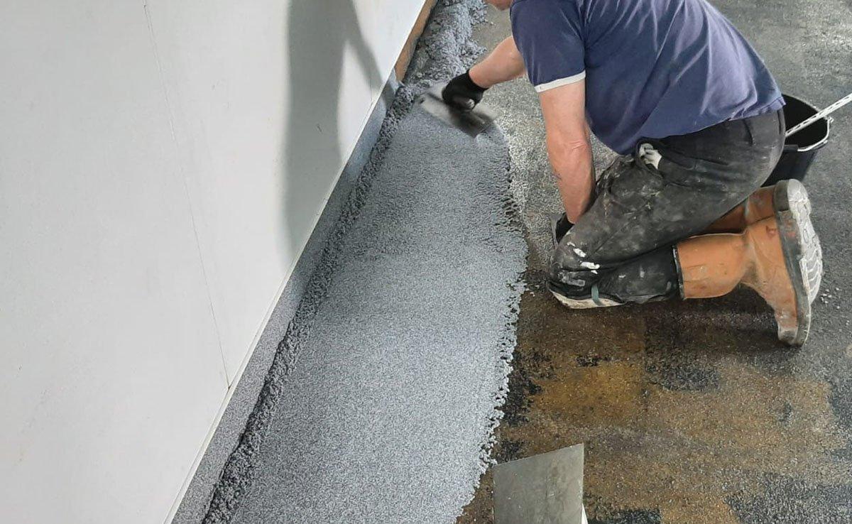 applying epoxy quartz system to new floor