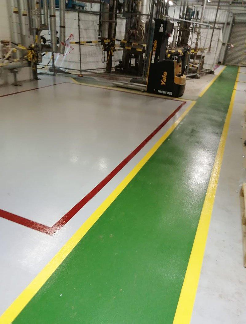 green and yellow floor demarcation