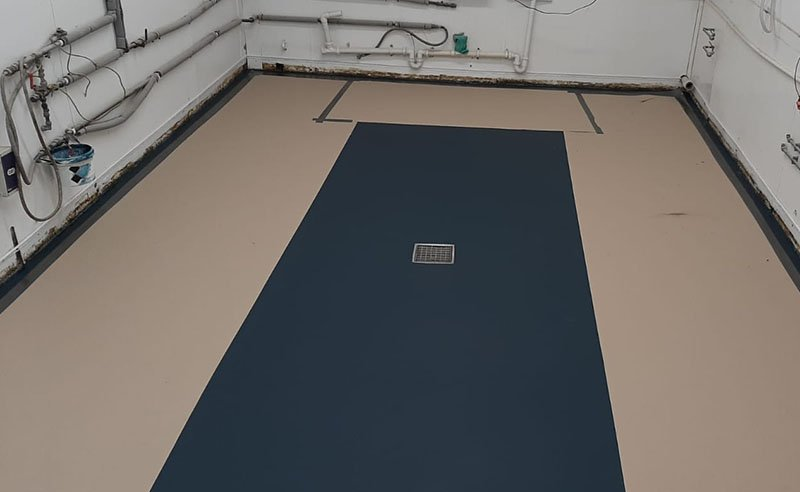 resin floor with stainless steel trap and basket