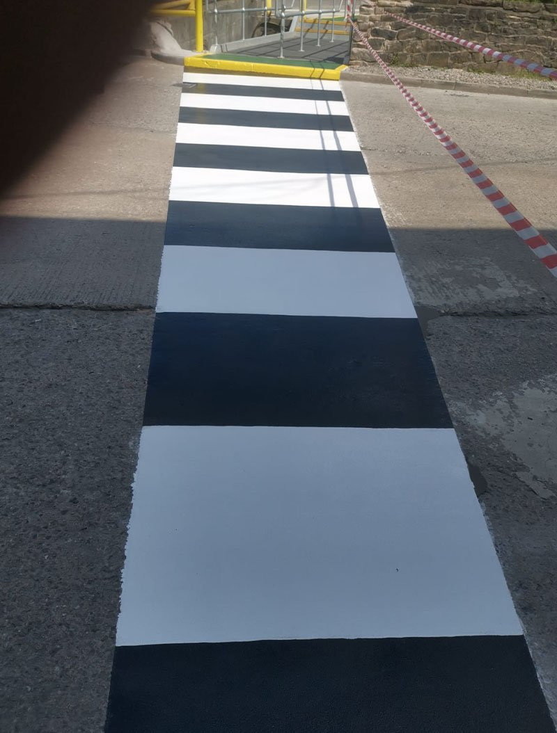 completed zebra crossing outside a factory