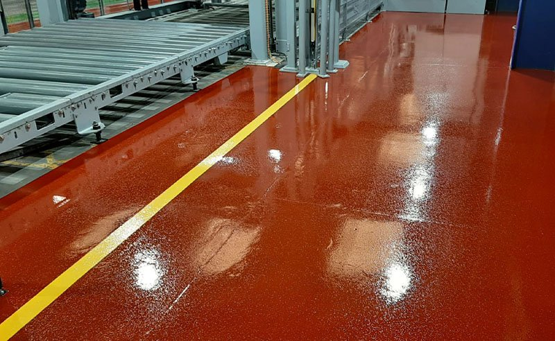 red resin flooring in a factory