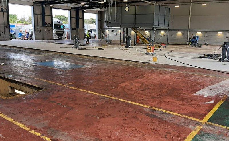 preparing concrete floor in a workshop